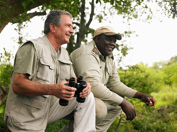 Local Safari guide helps spot wildlife on a game drive.