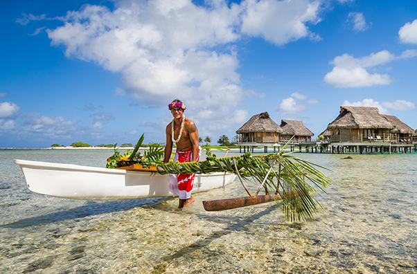 Traditional Outrigger floating in crystal clear waters.